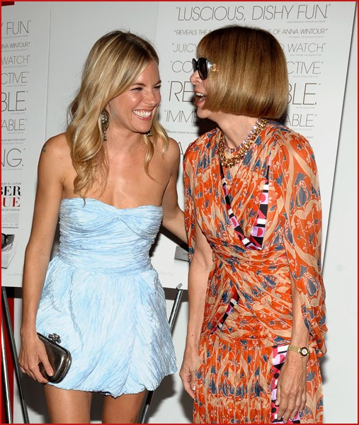 Wintour with Sienna Miller . . . laughing!